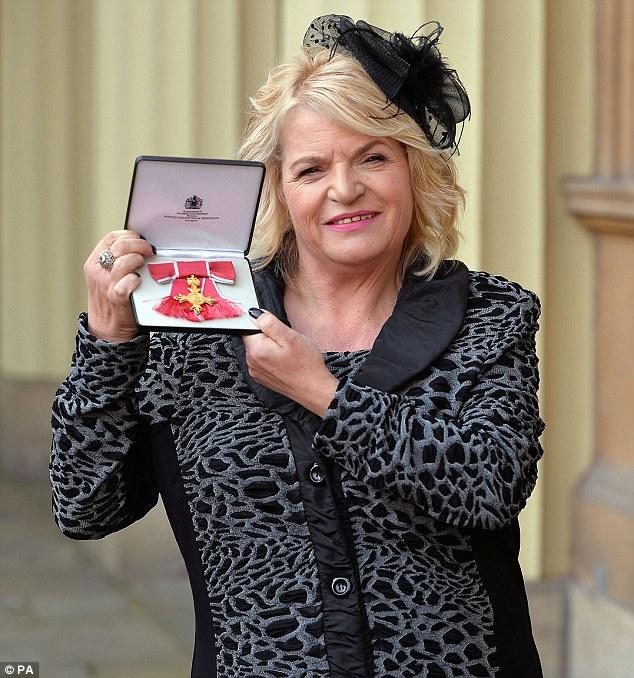 Mum of Sophie Lancaster receives OBE at Buckingham Palace (1/2)